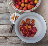 Chopped plum slices in a bowl for cooking jam Royalty Free Stock Photos