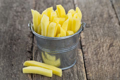 Chopped potato in a bucket on wooden table Royalty Free Stock Photography
