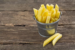Chopped potato in a bucket on wooden table Royalty Free Stock Images