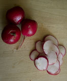 Chopped Radishes. Radishes on a cutting board Royalty Free Stock Image