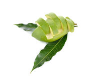 Chopped raw green mango with leaf on white. Background Stock Photography