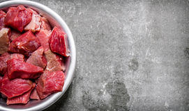Chopped raw meat in a cup. On stone table. Royalty Free Stock Photography