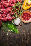 Chopped raw meat with vegetables, herb and spices for goulash on  rustic wooden background, top view. Place for text Stock Image