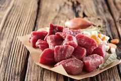 Chopped raw red meat with herbs and garlic stock photo