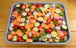 Chopped raw vegetables seasoned and drizzled with oil Royalty Free Stock Images