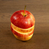 Chopped red appl. E on a wooden substrate Royalty Free Stock Photos