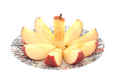 Chopped red apple on a dish Stock Image