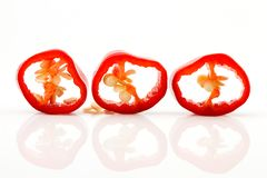 Chopped red chilli pepper or chilli cayenne pepper close up Stock Photos