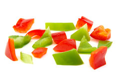 Chopped red and green pepper on white background. Royalty Free Stock Images