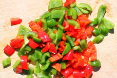 Chopped red and green peppers. Royalty Free Stock Images