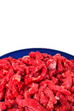 Chopped red meat on plate Stock Photography