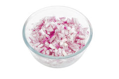 Chopped red onion in glass bowl Stock Photography