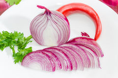 Chopped red onion, parsley and chili closeup Royalty Free Stock Images