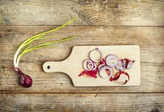 Chopped red onion on a wooden board Royalty Free Stock Photos