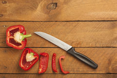 Chopped red paprika and knife on wood Royalty Free Stock Image