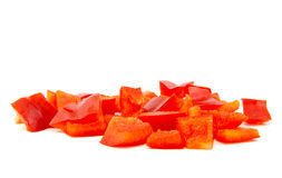 Chopped red pepper on white background. Chopped red pepper on a white background Stock Image