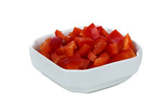 Chopped red pepper in white bowl Stock Photography