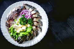 Chopped roasted and pickled herring with onions cheese and herbs Stock Photos