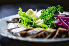 Chopped roasted and pickled herring with onions cheese and herbs Royalty Free Stock Photos