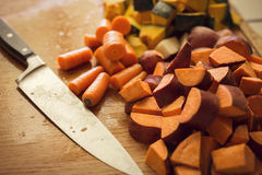 Chopped root vegetables in the kitchen Stock Photography