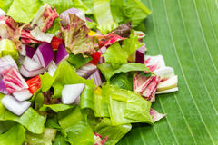 Chopped salad on banana leaf Stock Photos