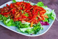 Chopped salad with peppers, lettuce and tomatoes Stock Image