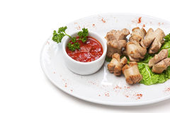 Chopped sausages fried with vegetables and spices Stock Photo