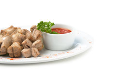 Chopped sausages fried with vegetables and spices Royalty Free Stock Image