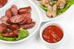 Chopped sausages Stock Images