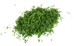 Chopped into small pieces fresh dill isolated on white Royalty Free Stock Photography