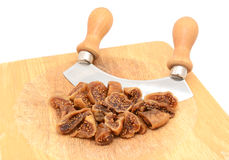 Chopped soft dried figs with a rocking knife Royalty Free Stock Image