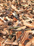 Chopped split logs. Vertical pile of chopped split logs for firewood Stock Photography