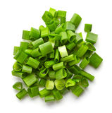 Chopped spring onions isolated on white, from above stock photos