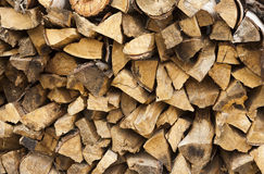 Chopped and stacked pile of pine and birch wood texture Royalty Free Stock Images