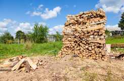 Chopped and stacked up dry firewood Stock Photos