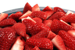 Chopped Strawberries. Fresh chopped strawberries in a bowl. Isolated for easy design use royalty free stock image
