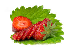 Chopped strawberries on green leaf isolated on white Stock Image