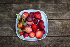 Chopped strawberries on plate Royalty Free Stock Photo