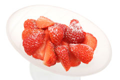 Chopped Strawberries and Sugar. Sliced/chopped strawberries with a sprinkling of sugar in a frosted glass bowl stock images