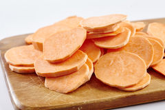 Chopped sweet potatoes on wooden board Stock Photography