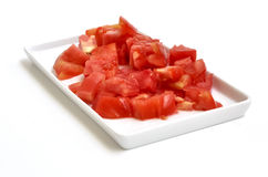 A chopped tomato. In a rectangular plate Royalty Free Stock Photography