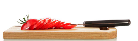 Chopped tomato and knife Royalty Free Stock Images