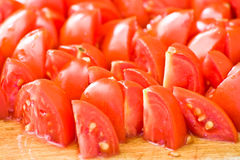 Chopped tomatoes. Close-up on wooden cutting board Royalty Free Stock Photos