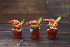 Chopped tomatoes, shrimps and olives in glass Royalty Free Stock Photos