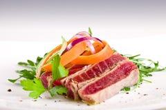 Chopped Tuna over fresh arugula salad Royalty Free Stock Images