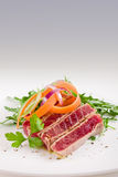 Chopped Tuna over fresh arugula salad Stock Images