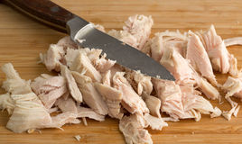 Chopped turkey on cutting board with knife Royalty Free Stock Photography