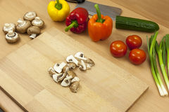 Chopped up chestnut mushroom laying on a chopping board Royalty Free Stock Images