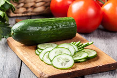 Chopped vegetables: cucumber on cutting board Stock Image