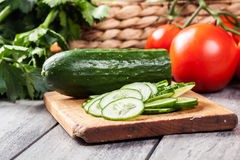 Chopped vegetables: cucumber on cutting board Stock Photography